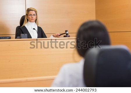 Lawyer listening to the judge in the court room