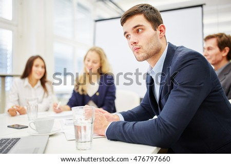 Lawyer looks meditative in a meeting in a conference room