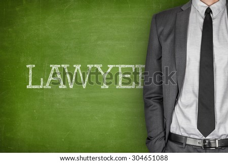Lawyer on blackboard with businessman in a suit on side - stock photo