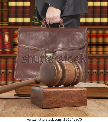Lawyer with a brown briefcase in the courtroom - stock photo