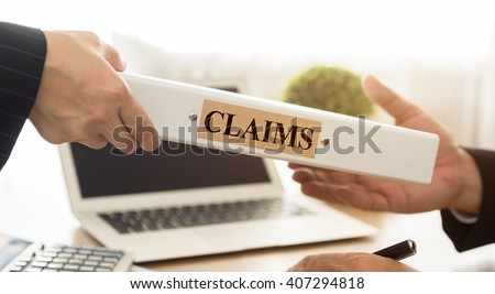 Lawyers filed a claims document of the customer to the insurance company. - stock photo