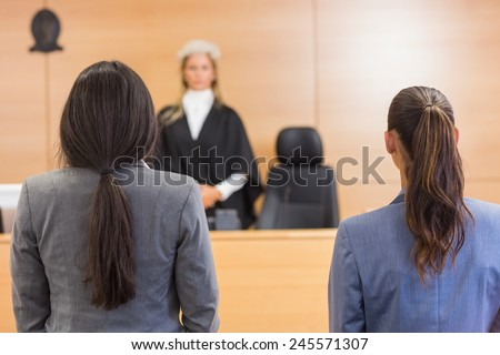 Lawyers listening to the judge in the court room