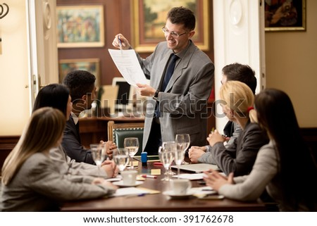 lawyers or attorneys discussing a document or contract agreement - stock photo