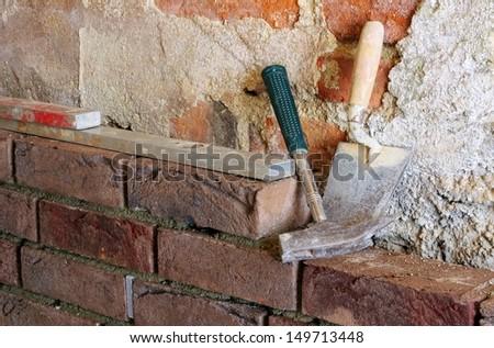 lay a brick wall  - stock photo
