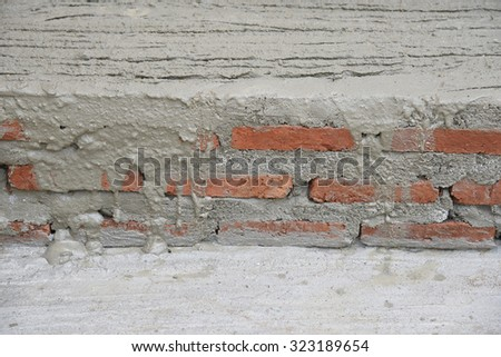 layer brick  in cement of  construction place - stock photo