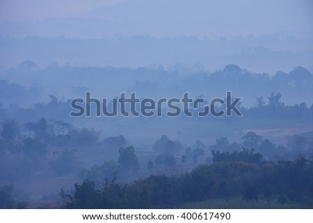 Layer hill in mist - stock photo