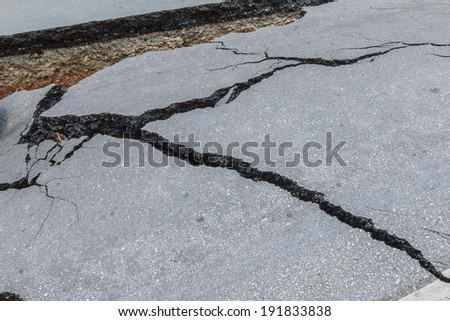 layer of broken asphalt road at rural areas - stock photo