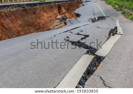 layer of broken asphalt road at rural areas - stock photo