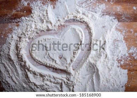 layer of flour to draw a heart on a cutting board