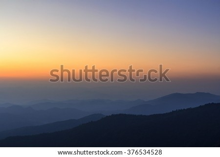 Layer of mountain and skyline after sunset
