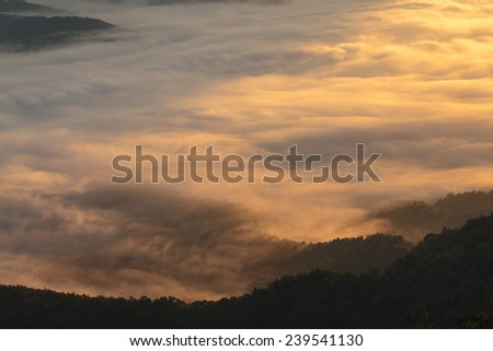 Layer of mountains in the mist at sunrise time - stock photo