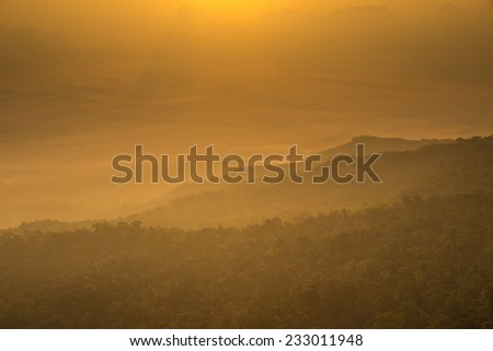 Layer of mountains in the mist at sunrise time.edit warm tone - stock photo
