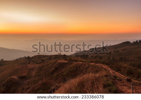 Layer of mountains in the mist at sunset .edit warm tone - stock photo