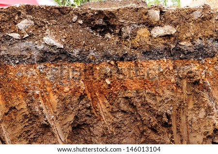 Layer of soil beneath the rural road - stock photo