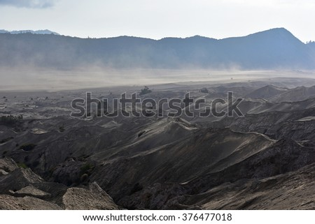 Layer Volcanic ash as sand ground of Mount Bromo volcano the magnificent view of Mt. Bromo located in Bromo Tengger Semeru National Park, East Java, Indonesia. - stock photo