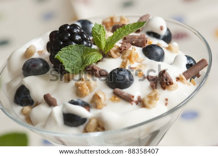 Layered berries, yoghurt and cereals in a glass - stock photo