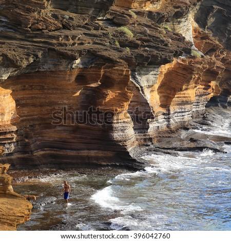 Layered cliffs of volcanic rocks, Costa del Silencio, Tenerife, Canary Islands, Spain. - stock photo