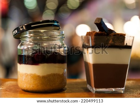 Layered freshly chocolates cake baked in a glass for serving as an individual dessert