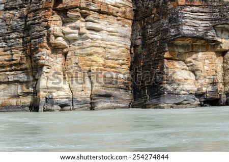 layered rocks on the Athabasca River in Canada - stock photo