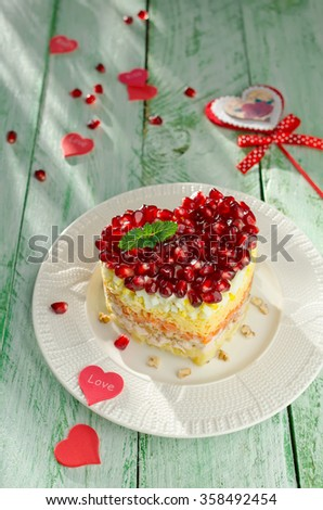 Layered salad from vegetables on the holiday table. Salad with walnuts, cheese, pomegranate and vegetables. Wedding day. Valentine's day - stock photo