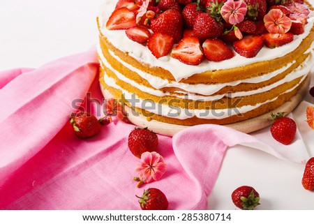 Layered, strawberry cake on the table - stock photo