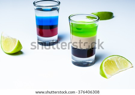 Layered strong cocktail in a glass  - stock photo
