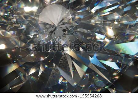 layered triangular macro diamond shapes with a small diamond over them      - stock photo