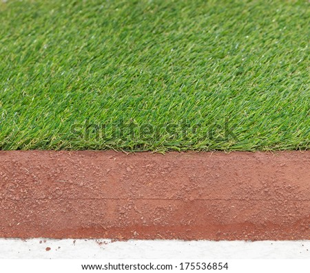 Layers of artificial synthetic grass for sports fields