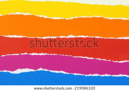 layers of colorful torn papers - stock photo