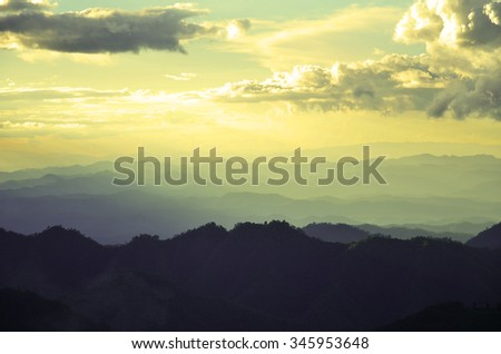 Layers of mountain and haze in the valleys is view beautiful - stock photo