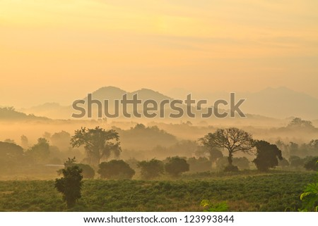 layers of mountains and fog at sunrise