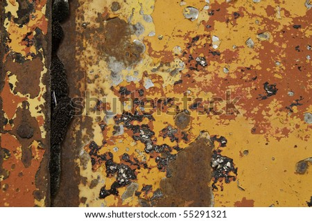 Layers of old paint on metal door. It is great for texture. - stock photo
