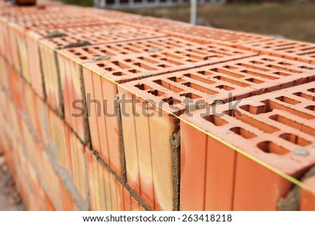 Laying bricks with a guideline - stock photo