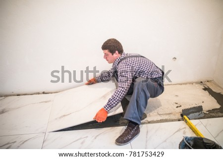 Laying Ceramic Tiles Worker Placing Ceramic Stock Photo Royalty