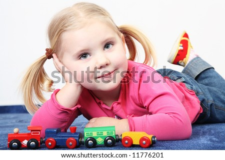 laying child girl cute beauty portrait - stock photo
