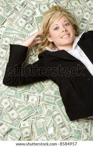 Laying in Money - stock photo
