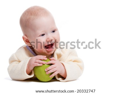 laying little boy portrait with green apple, copy space