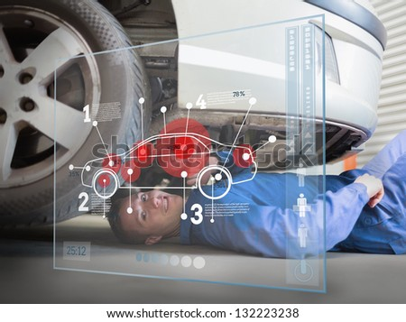 Laying mechanic consulting futuristic interface - stock photo