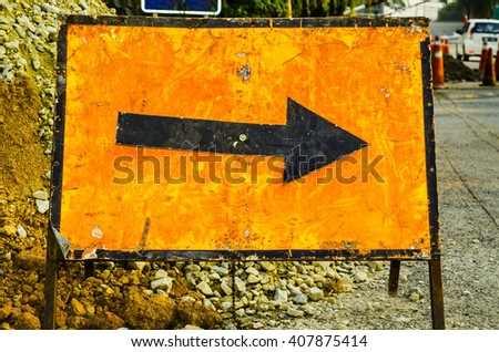 Laying new fibre-optic cables by the roadside by low-budget contractor / Diversion sign / Crude signs provided by the contractor involved - stock photo
