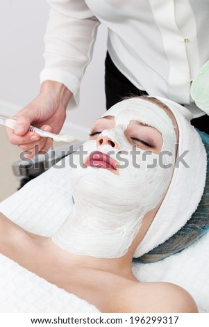 laying of mudpack in modern beauty salon