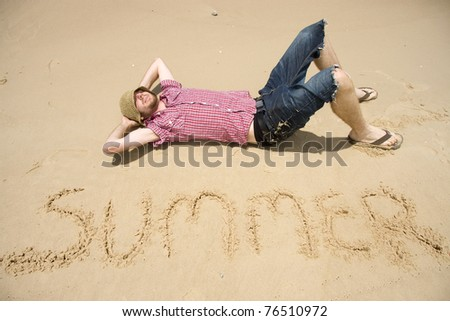 Laying On His Back, Relaxing On A Australian Beach And Enjoying One Of The Best Seasons Of The Year. - stock photo