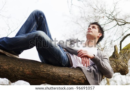 Laying on tree branch