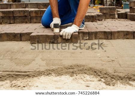 how to raise sidewalk slabs