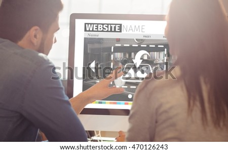 Layout of website with coffee maker against graphic designers working at desk in the office