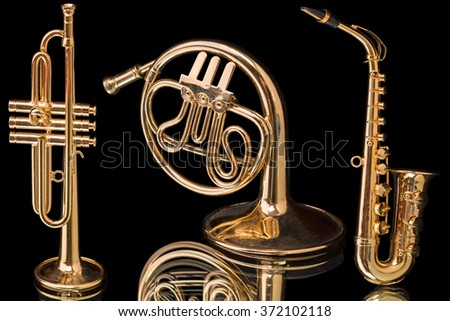 Layouts brass instruments isolated on a black background