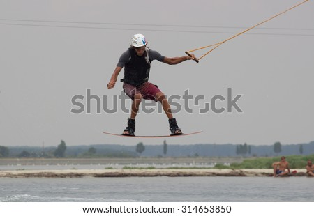 Lazurnoe , Ukraine, August 23, 2015:  Festival of music and sports Crayzy Day , Wakeboarder making tricks on sunset