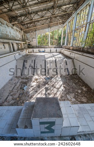 Lazurny (eng. Azure) swimming pool in Pripyat ghost town, Chernobyl Nuclear Power Plant Zone of Alienation, Ukraine - stock photo