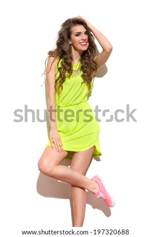 Lazy summer. Beautiful young woman posing in sunlight. Three quarter length studio shot isolated on white. - stock photo