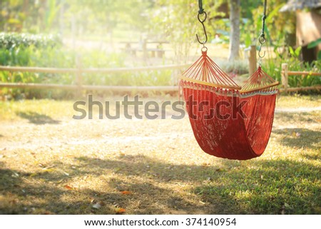 Lazy time with hammock in the summer garden, vintage toned. - stock photo
