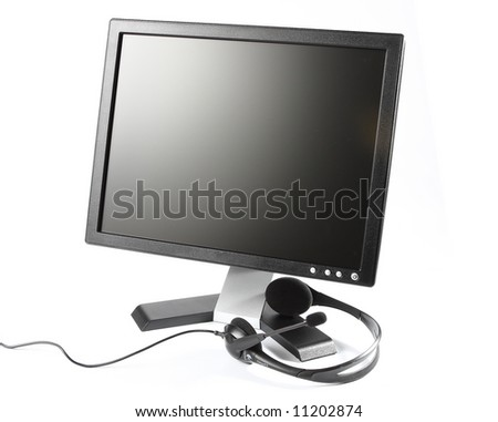 LCD high definition flat screen and headset - stock photo